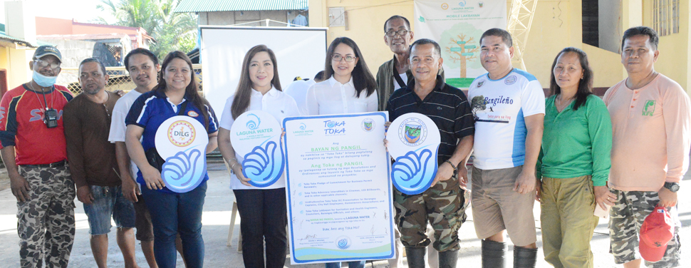 Laguna Water, in coordination with DILG IV-A, partners with the Local Government of Pangil in protecting the environment and ensuring pristine quality of their water systems. In photo: Laguna Water Stakeholder Relations Managers, Ana Martir (5th from left) and Dianne Marie Cunanan (6th from left); Pangil Mayor Oscar Rafanan (4th from right); and Pangil Vice Mayor Alfredo Pajarillo (3rd from right);  representatives from DILG IV-A; and barangay chairpersons of Pangil.
