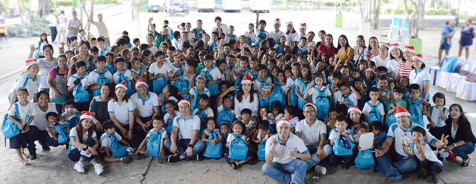 A Season of Giving. Ates and kuyas from Laguna Water bring smiles to more than 150 students of Dambo Elementary School in Pangil, Laguna through its Daloy ng Saya program, an environmental information, education, and communication campaign cum gift-giving activity.