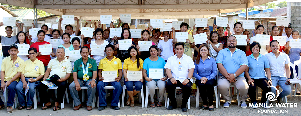 Clean water for all. One hundred household-beneficiaries of Tubig Para Sa Barangay program brandish their Certificate of Water Connection during a turnover ceremony, held March 10, 2016 in Florinda Compound, Brgy.Tubigan Biñan, Laguna.