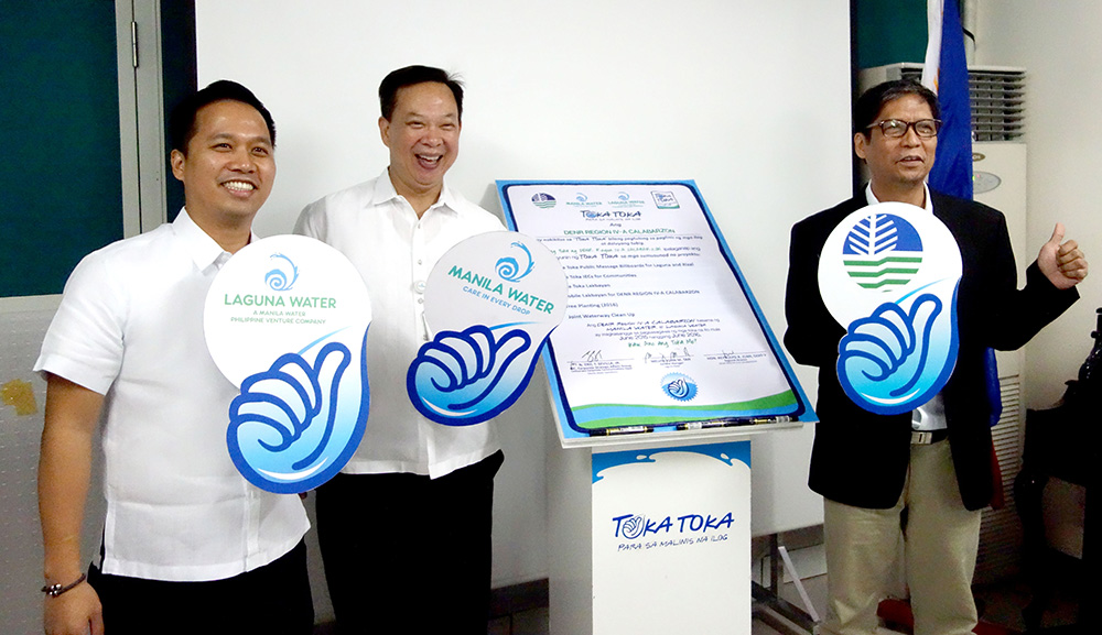 Photo shows (L-R): Laguna Water General Manager Melvin John Tan, Manila Water Branding and Market Research Head Fernando Busuego, and DENR-CALABARZON Regional Director Reynulfo Juan during the signing event.